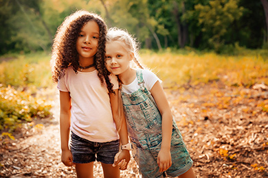 2 young girls in park
